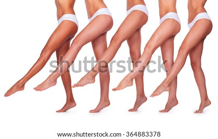 Slender and perfect. Close-up of five beautiful women in white panties stretching out their perfect legs while standing close to each other and against white background