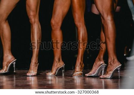 slender beautiful woman legs in high heels. women to compete in fitness bikini - stock photo