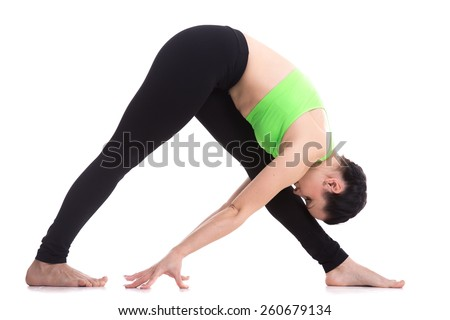 Slender fitness girl workout on white background, Intense Side Stretch yoga Pose, Parsvottanasana, exercise for shoulders and legs flexibility