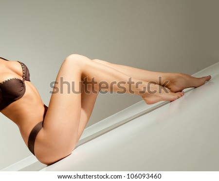 slender girl in a bikini - stock photo