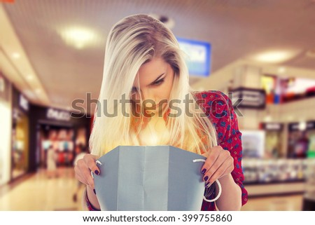 Slender girl with shopping bag in the shopping center. Beauty Woman with Shopping Bags in Shopping Mall. Shopper. Sales. Shopping Center - stock photo