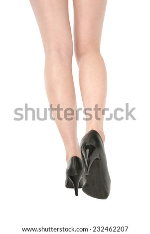 Slender legs of attractive woman on white background