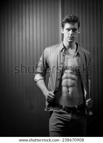 Slender Male With Shirt Open Exposing Washboard Abs