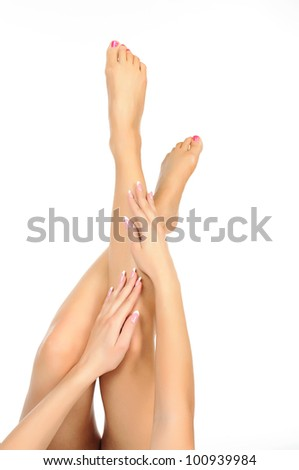 slender naked female  legs being massaged isolated on white - healthcare, hygiene and beauty concept - stock photo