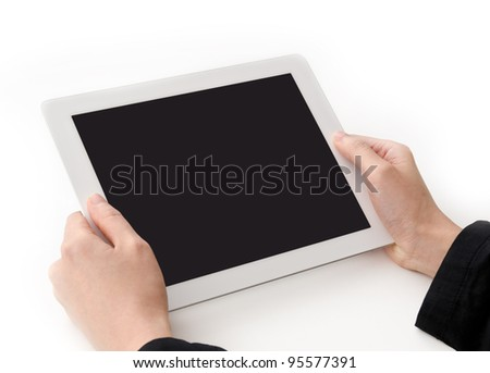 Slender woman hands holding a tablet computer on a white background - stock photo
