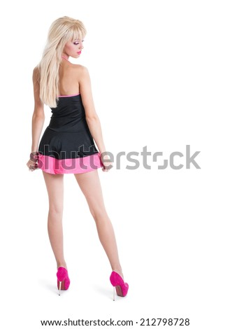 Slender young blonde woman in a dress  - stock photo