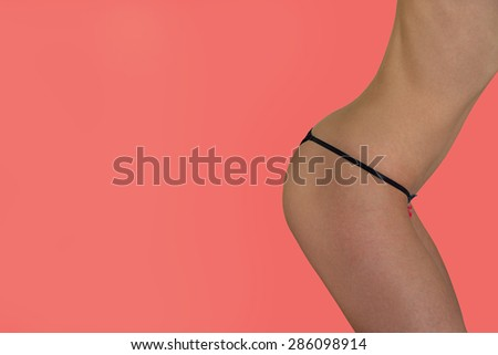 Slender young woman posing on pink background. - stock photo