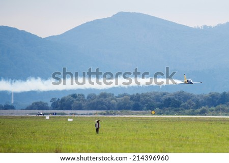 SLIAC, SLOVAKIA - AUGUST 30: Flight in low hight of Aero L-39 Albatros during speed race on SIAF airshow in Sliac, Slovakia on August 30, 2014 - stock photo