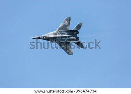 SLIAC, SLOVAKIA - AUGUST 30: Flight of Mig 29 Fulcrum of Polish Air Forces at SIAF airshow in Sliac, Slovakia on August 30, 2015