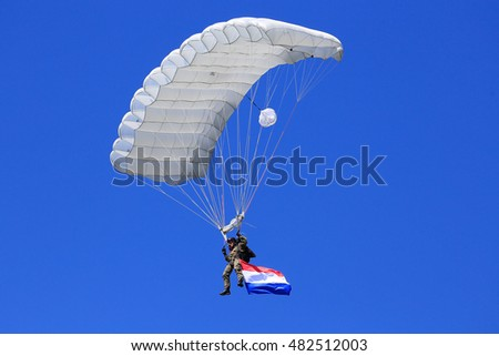SLIAC, SLOVAKIA - AUGUST 30: parachutist with France flag in the air at SIAF airshow in Sliac, Slovakia