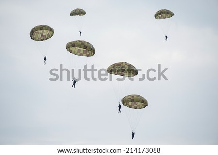 SLIAC, SLOVAKIA - AUGUST 30: Paratroopers in the air during SIAF airshow in Sliac, Slovakia on August 30, 2014 - stock photo