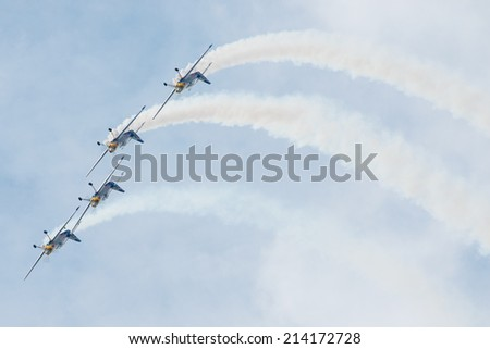 SLIAC, SLOVAKIA - AUGUST 30: The flying bulls aerobatics team from Czech republic performs flight maneuver on the SIAF airshow in Sliac, Slovakia on August 30, 2014