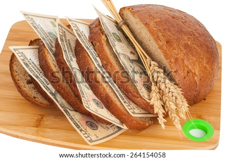 Slice bread with money - stock photo