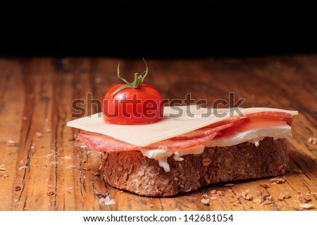 slice bread with salami cheese and tomatoes - stock photo