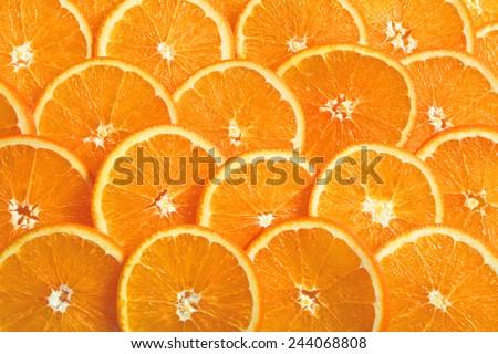 Slice fresh orange fruit background. - stock photo
