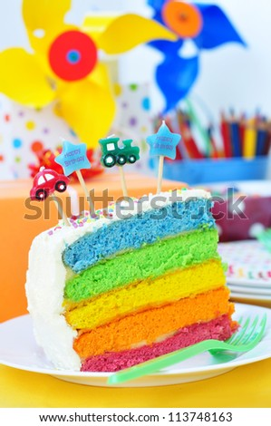 Slice of a birthday rainbow cake  for kids party