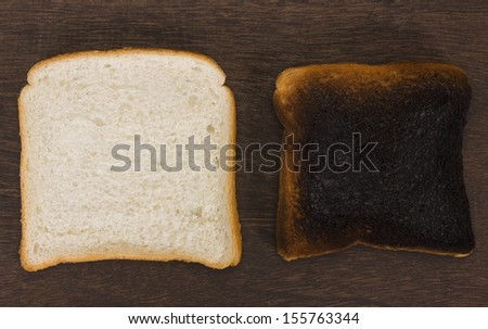 Slice of a bread with a burnt toast