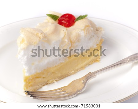 Slice of a delicious traditional homemade lemon ,meringue pie with a dessert fork. - stock photo