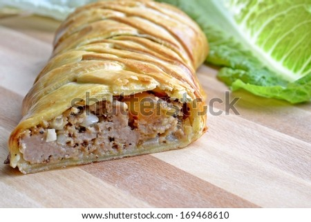 Slice of a home made meat pie with dried fruit and mustard seads - stock photo