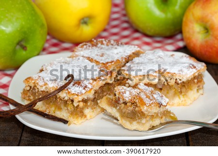 Slice of apple cake ready to eat with a fork