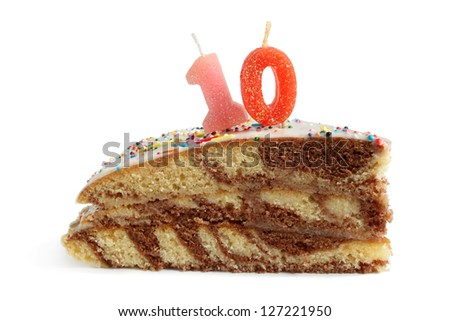 Slice of birthday cake with number ten candle on a white background - stock photo