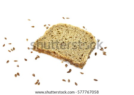 Slice of black bread with linseed and sunflower seed isolated on white background.