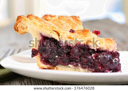 Slice of Blueberry Pie on rustic wooden table - stock photo