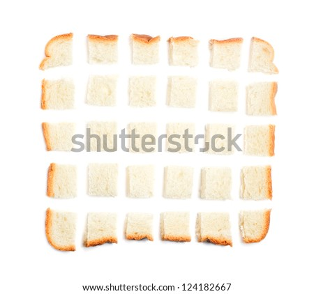 Slice of bread chopped in pieces on white background