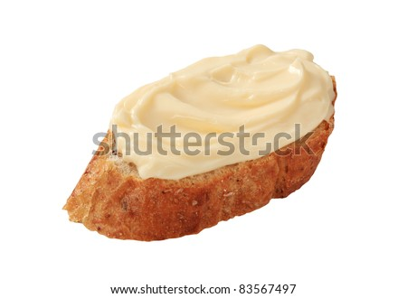 Slice of bread roll and creamy cheese spread