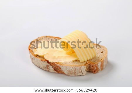 slice of bread with butter - stock photo