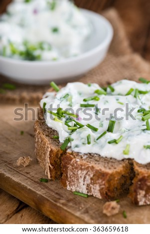 Slice of Bread with fresh made Herb Curd (detailed close-up shot) - stock photo