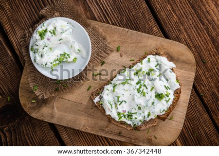 Slice of Bread with fresh made Herb Curd (detailed close-up shot)