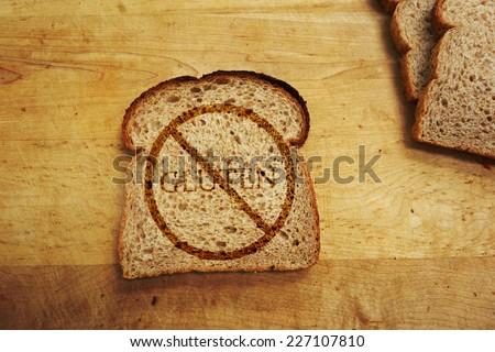 Slice of bread with Gluten text - Gluten Free diet concept                                - stock photo