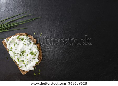 Slice of Bread with Herb Curd (detailed close-up shot) - stock photo