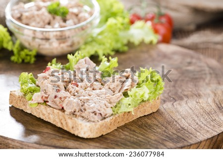 Slice of bread with Tuna salad (on wooden background) - stock photo