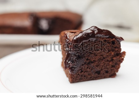 Slice of brownie on a white plate. - stock photo