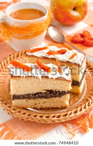 Slice of cake with poppy seeds and apricot decor