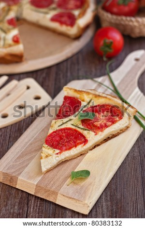 Slice of cheese and tomatoes tart