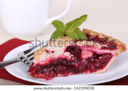 Slice of cherry fruit pie on a plate