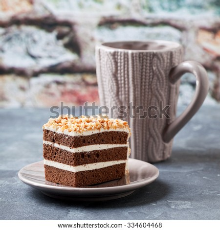 Slice of chocolate and nut layers cake, selective focus - stock photo