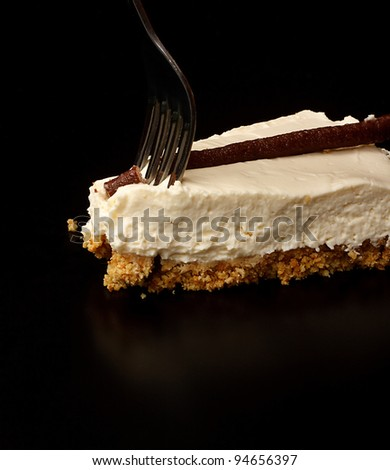 Slice of Chocolate and Orange Cheesecake with Fork