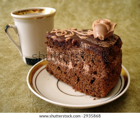 slice of chocolate cake on plate and cup - stock photo