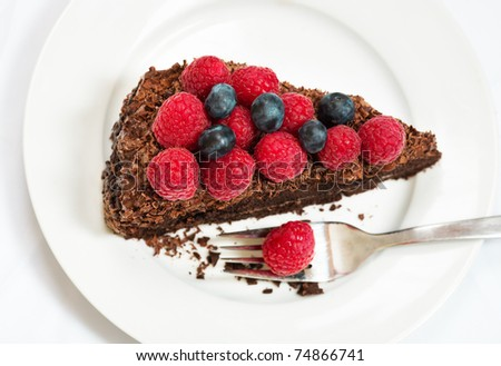 Slice of chocolate cake with berries - view from above - stock photo