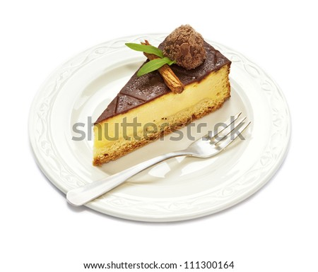 Slice of chocolate covered cheesecake with truffle served on plate ...