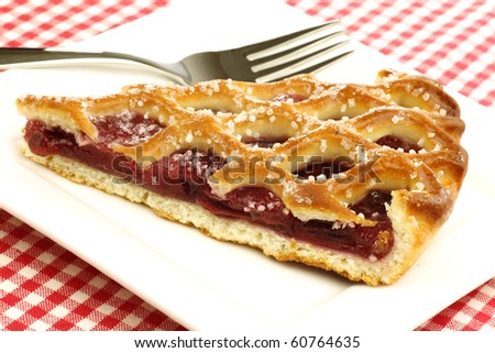 """slice of decorated cherry pie called """"vlaai"""" in Holland on a white plate - stock photo"""