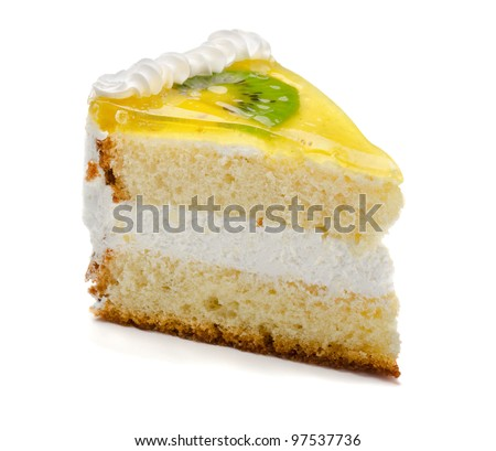Slice of delicious fruit kiwi cake isolated on white