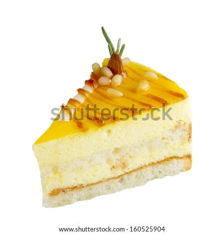 Slice of delicious mango cake isolated on white  - stock photo