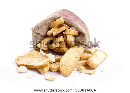 slice of dry bread and jute on isolated background - stock photo