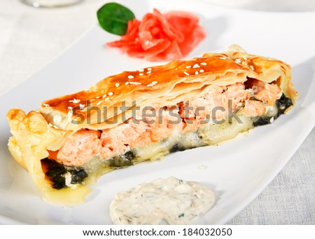 Slice of fish pie with spinach and cheese closeup. - stock photo
