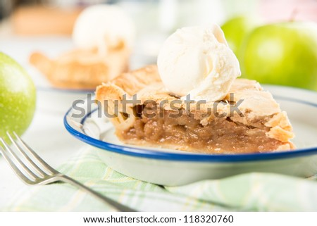 Slice of Fresh Homemade Apple Pie with Scoop of Ice Cream - stock photo